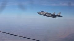 US Air Force – Lightning II fly beside air refueling aircraft Stock Footage