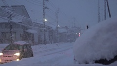 Car Buried In Snow Next To Busy Road In Blizzard Stock Footage