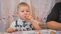 Board games. Boys inflate balloons, emotions fear closeup,in profile Stock Footage