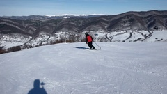 Slow Motion Rear View of Professional Skier Carving Down the Snowy Slope Stock Footage