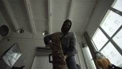 Man folds a tripod in case Stock Footage