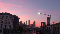 CLOSE UP: Sightseeing tour with bus across the Lower Manhattan at pink dawn Stock Footage