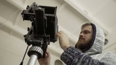 Man demount retro camera close-up Stock Footage
