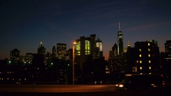 CLOSE UP: Driving on highway towards city lights of Manhattan downtown by night Stock Footage