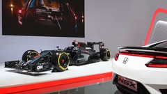 McLaren-Honda MP4-31 Formula 1 race car and Honda NSX hybrid sports car Stock Footage