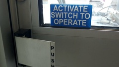 Activate switch to operate sign on a glass door inside the hospital Stock Footage