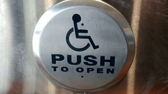 Push to open button for people with disabilities, seniors and on wheelchairs Stock Footage