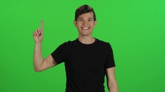 A young man points upwards (use for pop-up's) Stock Footage