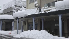 Man Shovels Deep Snow From Roof Top After Winter Storm Stock Footage