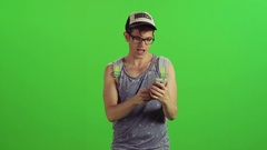 Hipster filters a phone call from a blocked number, two takes. Stock Footage
