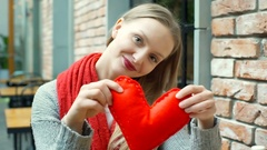 Pretty girl holding handmade heart and showing it to the camera Stock Footage