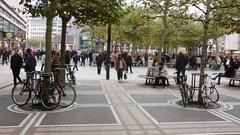 GERMANY - CIRCA - People crowd walk on busy street, Frankfurt am Stock Footage