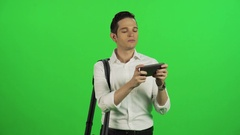 A young businessman  using an app while walking. Stock Footage