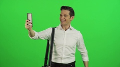 A young businessman taking a selfie, while walking. Stock Footage