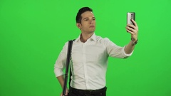 A young businessman taking a selfie while walking. Stock Footage
