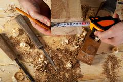 Carpenter working, hammer, meter and screw-driver on construction background. Kuvituskuvat