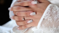Bride clasped hands Stock Footage