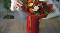 Woman rotating bouquet of fruits: lime, strawberry, pomegranate, marshmallow Stock Footage