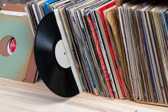 Vinyl record with copy space in front of a collection of albums dummy titles Stock Photos