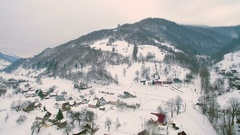 4K Mountain village with residential house covered by heavy snow storm fall in Stock Footage