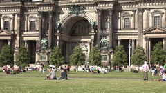 4K People relax on green grass Berlin famous cathedral facade statue decoration Stock Footage