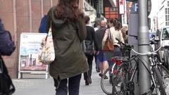 4K Busy sidewalk in suburban area pedestrian people commute in Berlin local shop Stock Footage