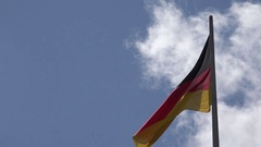 4K Germany flag wave in sunny day national symbol landmark iconic identity proud Stock Footage