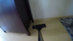 Person clean dust after cupboard with vacuum cleaner. 4K Stock Footage