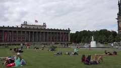 4K Pan right tourist people relax on grass Lustgarten in famous Berlin Cathedral Stock Footage