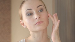 Closeup portrait of beautiful woman touching face skincare concept Stock Footage