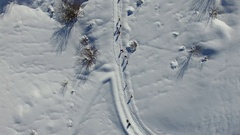 Flat lay aerial view slow of snowy landscape with hikers in Abruzzo, Italy. Stock Footage