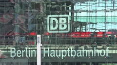 4K Main train station of Berlin city modern glass facade architecture people day Stock Footage