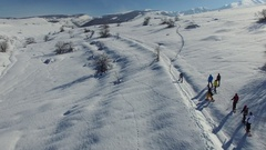 Aerial view of snowy landscape with hikers in winter in Abruzzo. Stock Footage