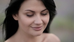 Young beautiful dark-haired woman walking and dancing in a field of lavender. Stock Footage