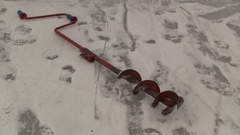 Auger on river ice Stock Footage