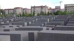 4K Tourist people visit Jewish Holocaust Memorial victim in Berlin historic icon Stock Footage
