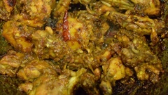 Smoking hot chicken curry being made Stock Footage