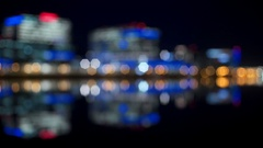 Building reflections on Tempe Town Lake at night Stock Footage