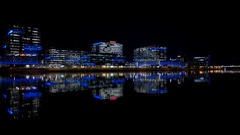 Evening building reflections on Tempe Town Lake Stock Footage
