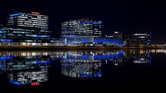 Shimmering reflected lights on Tempe Town Lake at night Stock Footage