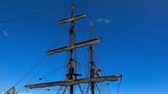Mast yacht on a background of blue sky. 4K. Stock Footage