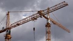 4K Timelapse crane equipment work on construction site new estate building house Stock Footage