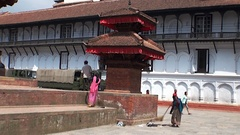 Women sweep the streets of Durbar Square Kathmandu Nepal. Stock Footage
