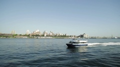 NEW YORK -  A New York Water Taxi boat heads south on the Hudson River Stock Footage