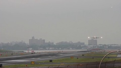 Head on shot down runway of airliners taking off and landing at Airport on a Stock Footage