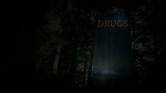 Pan of tombstone with drugs written at top death from drugs or death of drugs Stock Footage