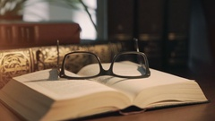 Old books on desktop - film style Stock Footage