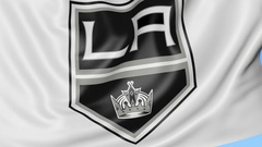 Close-up of waving flag with Los Angeles Kings NHL hockey team logo, seamless Stock Footage