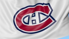Close-up of waving flag with Montreal Canadiens NHL hockey team logo, seamless Stock Footage
