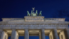 4K Nightfall Brandenburg Gate ancient monument in Berlin twilight tourism iconic Stock Footage